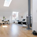 Egy tetőtér is csobálatos otthont teremthet számunkra a megfelelő színek és lakberendezési trükkök használatával.